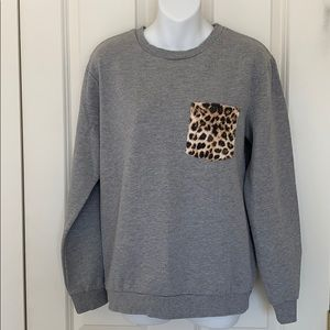 Cheetah pocket crewneck